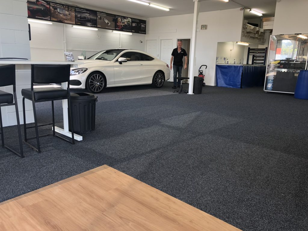 person inside yes anytime Roadworthys store next to white car